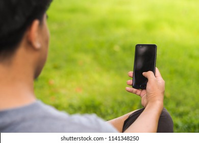 Closeup of male hands using mobile smartphone with blank screen and copy space for design or text message