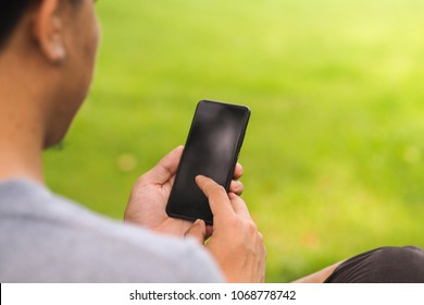 Closeup of male hands using smartphone with blank screen with copy space for design or text message