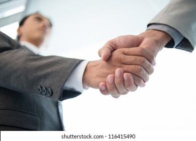 Close-up of male handshake
