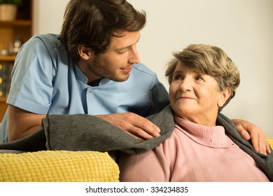 Close-up of male nurse caring about retiree