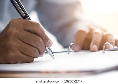 Closeup male senior hand writing Sign contract document concept