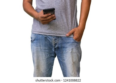 Closeup of man in blue jeans using smart phone and hands in pockets of their jeans on white background.