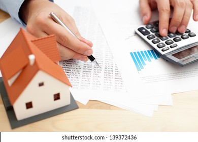 Closeup of man counting payments for home