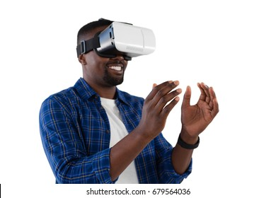 Close-up of man gesturing while using virtual reality headset