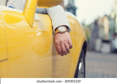 Closeup of man hand with golden watch in car