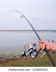 Closeup of a man hand holding a fishing rod and reel