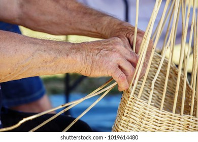 Closeup of man hand making a wicker can bamboo basket