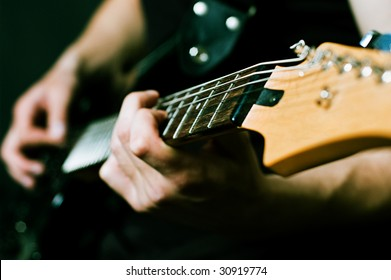 close-up of man hands on guitar
