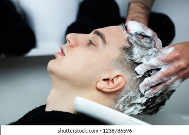 Close-up of  man having his hair woshed in hair salon