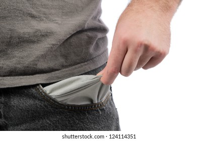 Closeup of a man holding out his empty pocket, isolated on a white background.