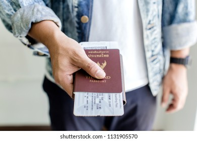 Closeup of Man holding passports and boarding pass,Business travel concept