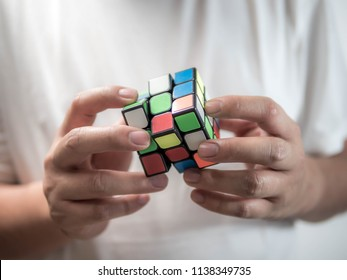 Close-up man holding rubik's cube, brain training