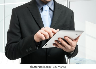 Closeup of a man holding a tablet pc