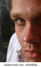 A closeup of a man looking into camera