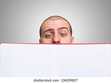 Closeup of a man looking at an open book