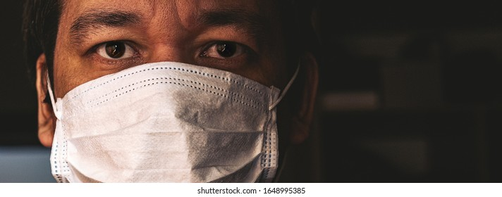 Closeup of man in mask, concept of viral infection. Theme of corona-virus epidemic.