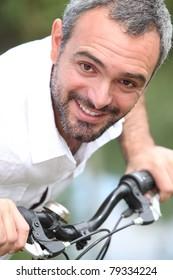 close-up of a man on a bike