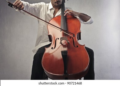 Closeup of a man playing the cello