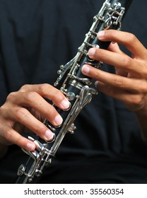 Closeup of a man playing a clarinet