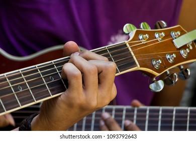 Close-up man playing guitar selective focus - important instrument in samba and chorinho Brazilian music