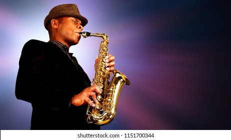 Close-up man playing on saxophone on blurred