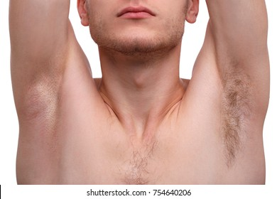 Close-up of a man raising his hands and showing his armpits, one armpit shaved, the second is not, isolated on white background.
