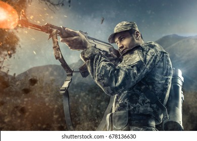 Close-up of man shooting with machine gun