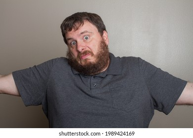 closeup of a man shrugging his shoulders make a whatever expression on his face
