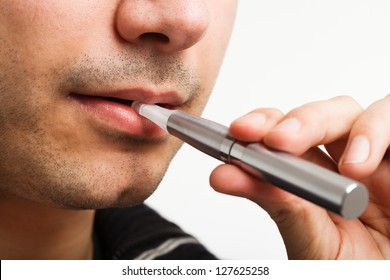 Close-up of a man smoking an electronic cigarette