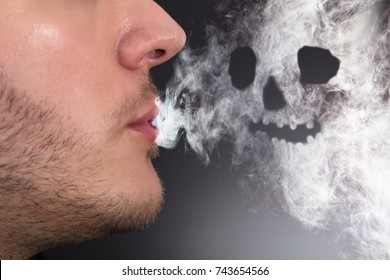 Close-up Of A Man Smoking Skull Shape Formed