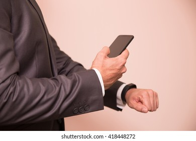 Close-up of a man syncing his smartwatch and smartphone