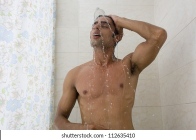Close-up of a man taking a shower