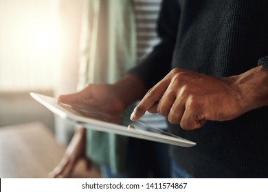 Close-up of a man touching on digital tablet