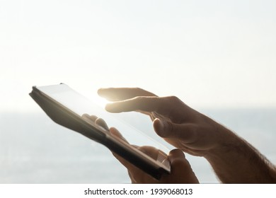 Closeup of man using digital tablet device - Hands of man typing and surfing internet and social media - Technology and lifestyle