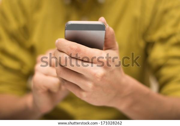 Closeup of man using smart phone