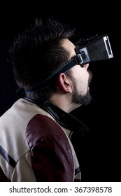 Close-up of man in vr glasses playing games and reaction