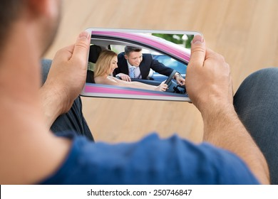 Close-up Of A Man Watching Video On Cellphone