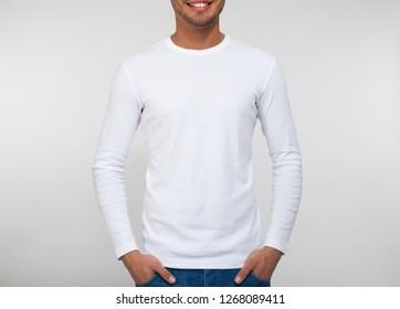 Close-up of a man wearing a long blank t-shirt