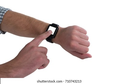 Close-up of man wearing smartwatch against white background