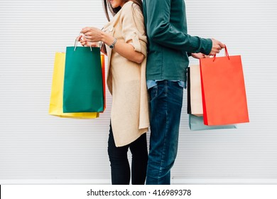 Closeup of man and woman holding their shopping bags