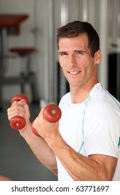 Closeup of man working out in gym