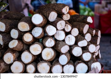 Closeup of a lot of Manihot esculenta to sell in the street market. commonly called cassava, macaxeira, yuca, aipim, mandioca and brazilian arrowroot.