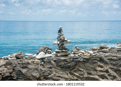 Closeup of manmade cairn, stacked rocks, on textured structure on the Caribbean Sea waterfront on St. Croix in the US Virgin Islands