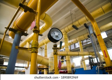 Closeup of manometer, pipes and faucet valves of heating system in an industrial boiler room. City heating system