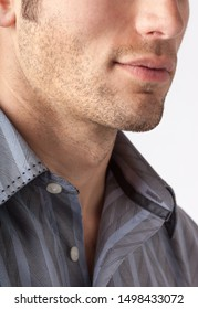 Close-up of man's chin and jawline with facial hair beard stubble five o'clock shadow. Men's personal care and grooming.