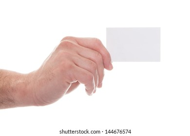 Close-up Of Man's Hand Holding Blank Visiting Card On White Background
