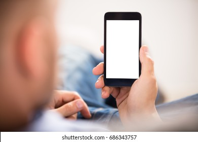 Close-up Of A Man's Hand Holding Cell Phone With White Blank Screen