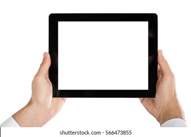 Close-up Of Man's Hand Holding Digital Tablet On White Background