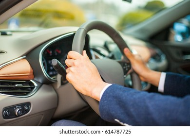 Close-up of a man's hand holding a handle/right attitude of driving/side view of a car driver