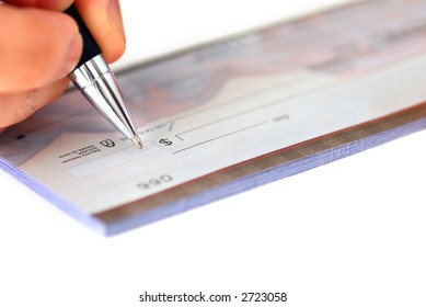 Closeup of man's hand writing a cheque